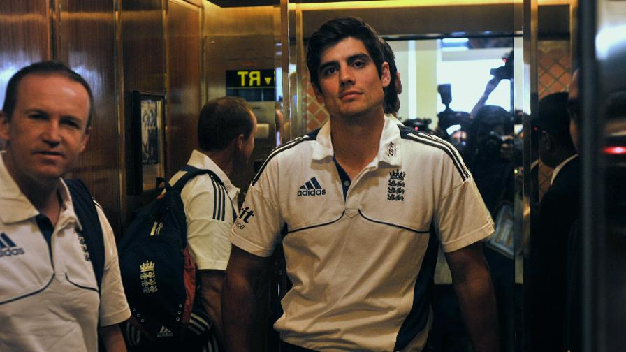 In the media spotlight - Alastair Cook and Andy Flower face a throng of cameras on the India tour in 2012
