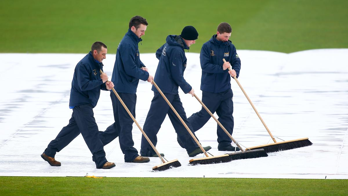 Four pronged attack - The Hampshire groundstaff working hard to get the game on