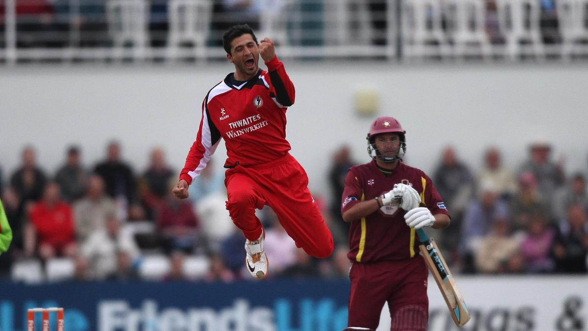 Junaid Khan celebrates a wicket for Lancashire in 2011