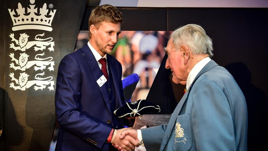 Joe Root presents Doug Insole (90) with his commemorative England cap