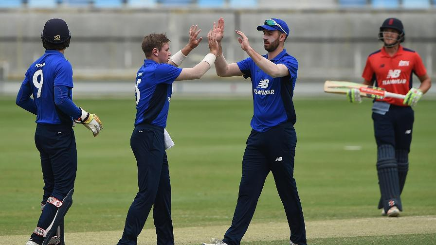 Leg-spinner Mason Crane celebrates his first wicket against the North with skipper James Vince