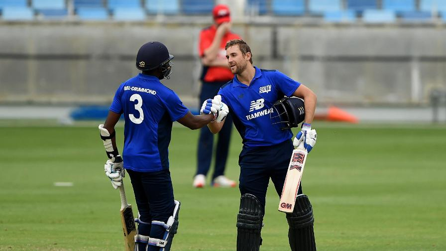 Dawid Malan celebrates his century for the South with opening partner Daniel Bell-Drummond