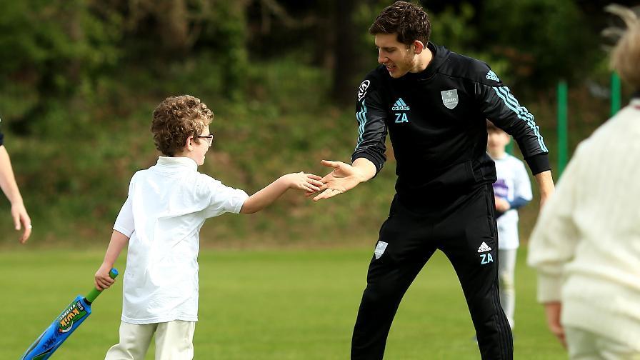 Zafar Ansari plays cricket with young volunteers at Streatham & Marlborough