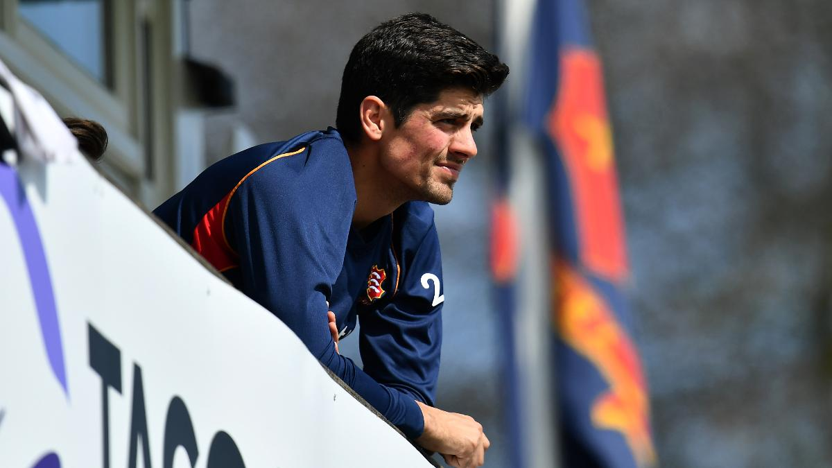 Former England captain Alastair Cook - injured - looks on at Chelmsford