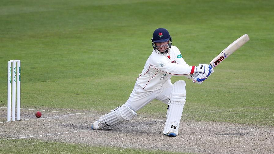Maiden Davies ton puts Lancs in charge