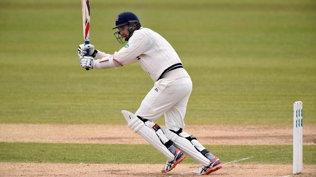 Steven Finn hits one away while standing firm for Middlesex