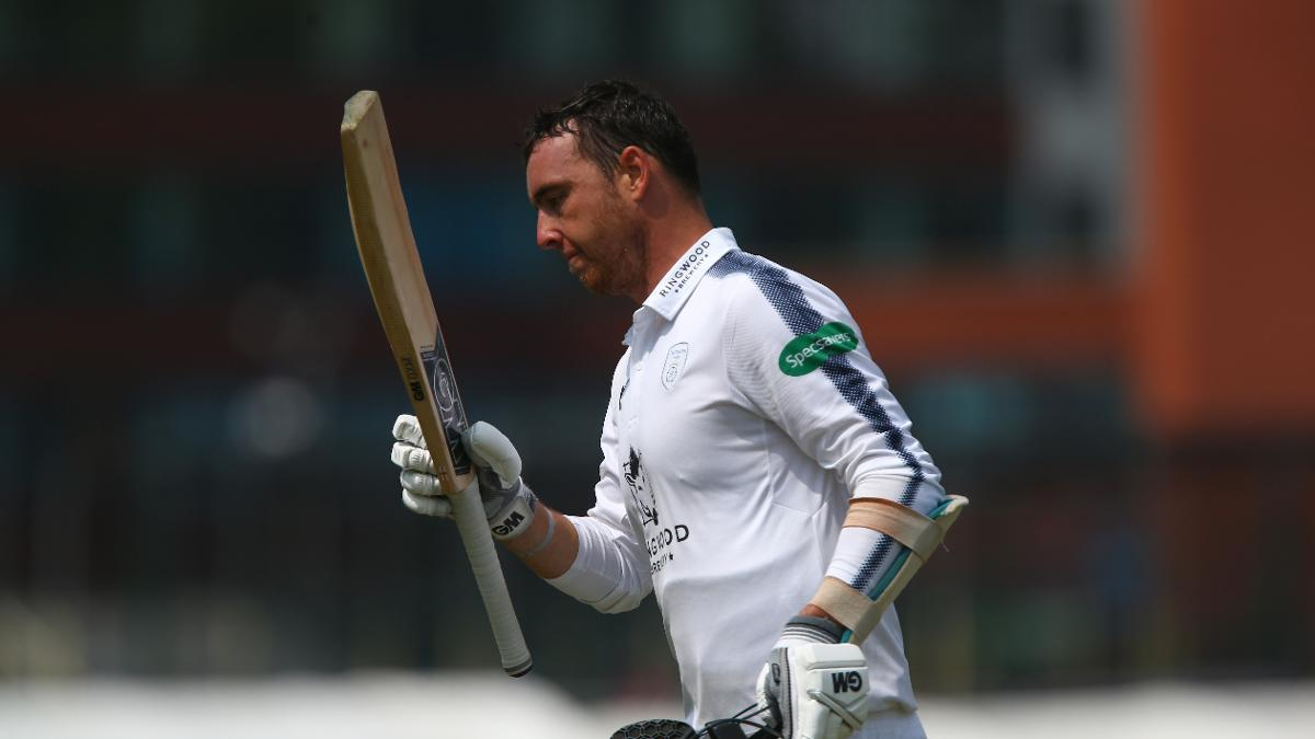 THE EXTRA KYLE - Abbott salutes the crowd as he trudges off unbeaten on 97, three runs short of his maiden first-class hundred