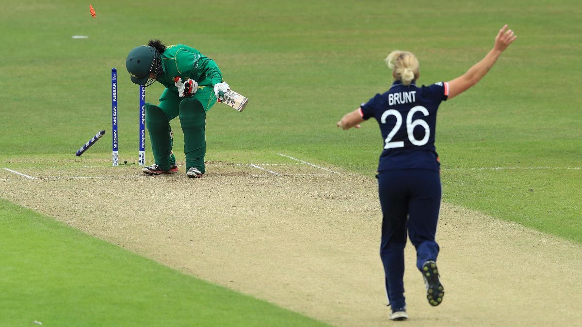 Katherine Brunt celebrates after knocking out Javeria Khan's middle stump