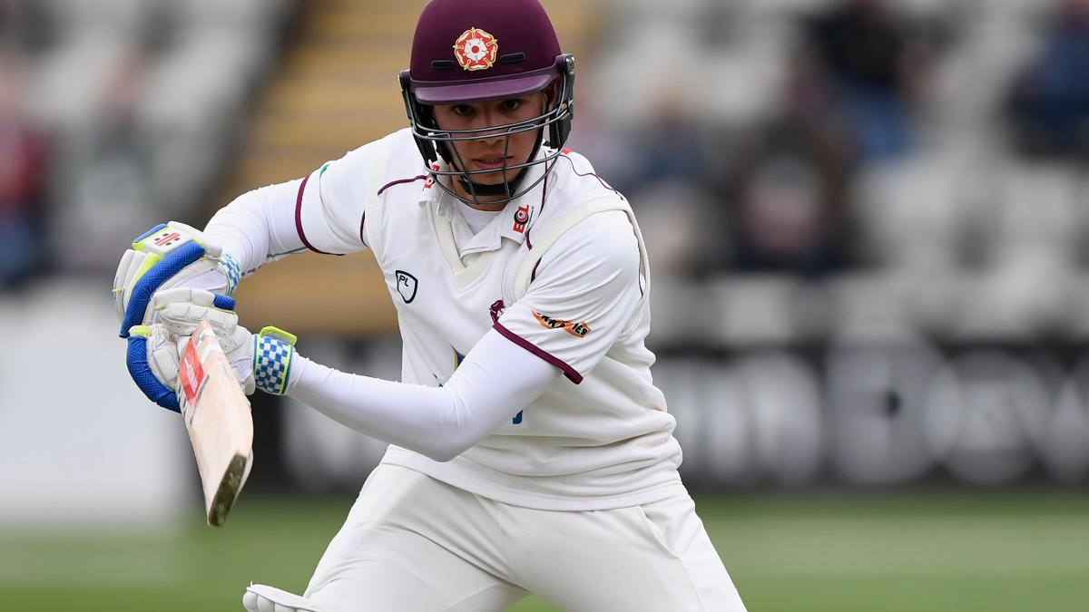 Max Holden on the way to scoring his maiden first-class hundred while on loan at Northamptonshire