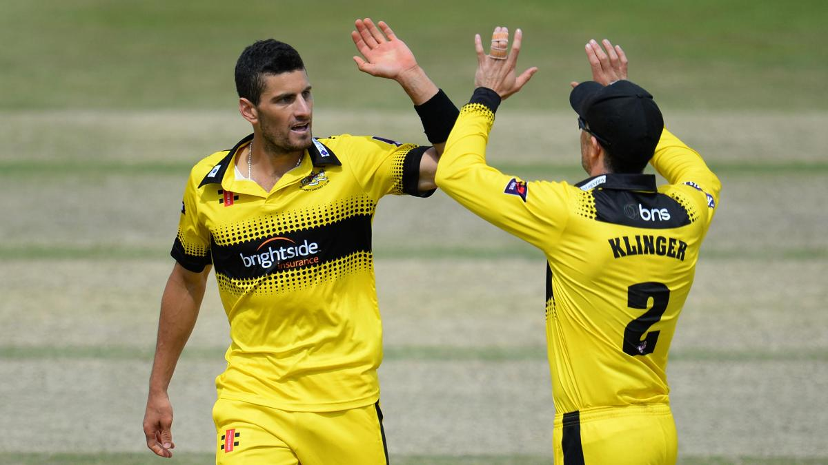 Benny Howell celebrates taking a wicket against Kent