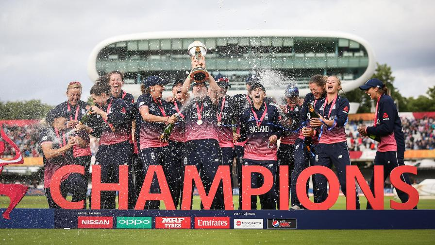 Heather Knight is drenched in champagne as she lifts the World Cup