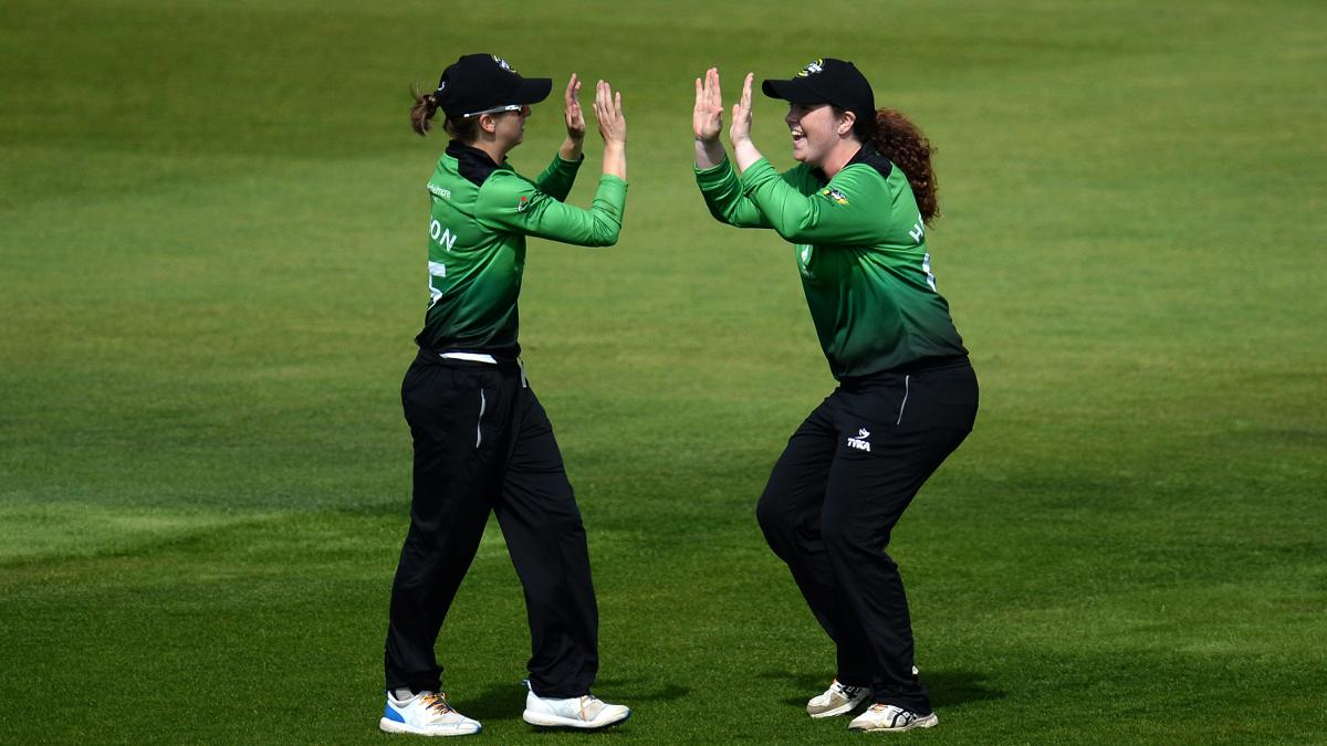 Fran Wilson celebrates with Georgia Hennessy after taking a catch