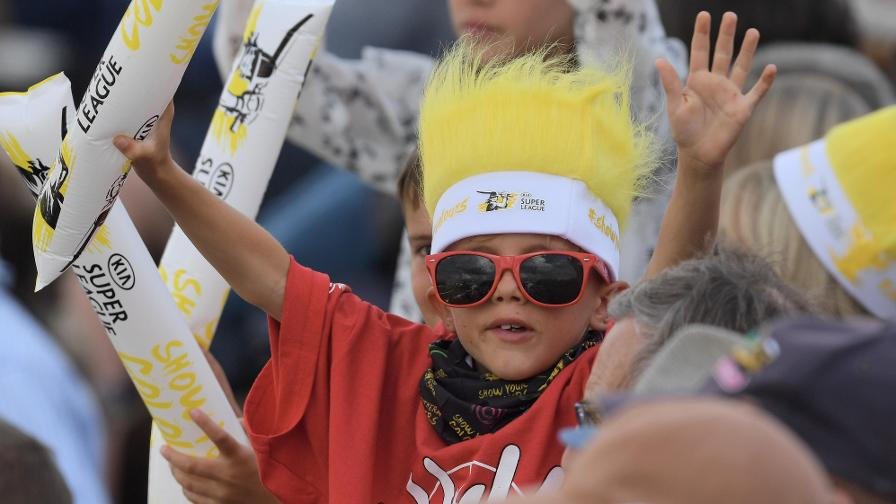 HANDS UP IF YOU'RE HAVING FUN – a young fan enjoys proceedings