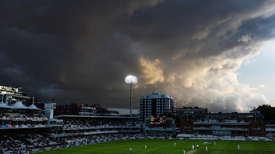 Storm clouds tower over the Lord's pavilion during play