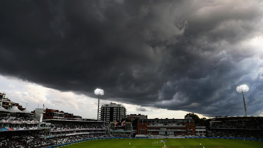 Massive towering storm clouds roll over Lord's during play in the Investec Test against West Indies