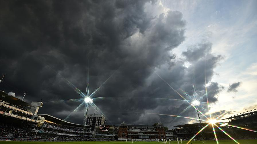 The Lord's floodlights take effect as the huge clouds roll in over the ground