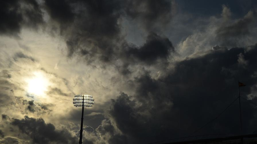 The sun tries it's best to burn through the clouds as the Lord's floodlights take effect