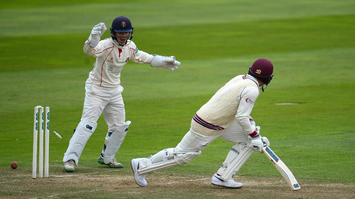 QUICK REACTIONS - Alex Davies celebrates as he stumps Dom Bess