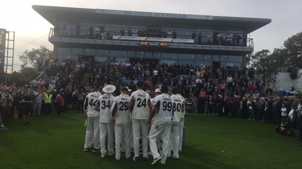 The Worcestershire players take the applause from their fans after clinching the Division Two title