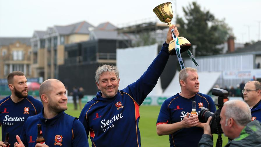 Chris Silverwood holds aloft the Specsavers County Championship trophy