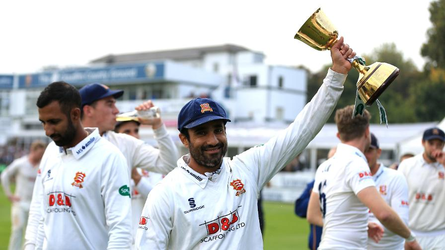 Ravi Bopara holds the trophy aloft