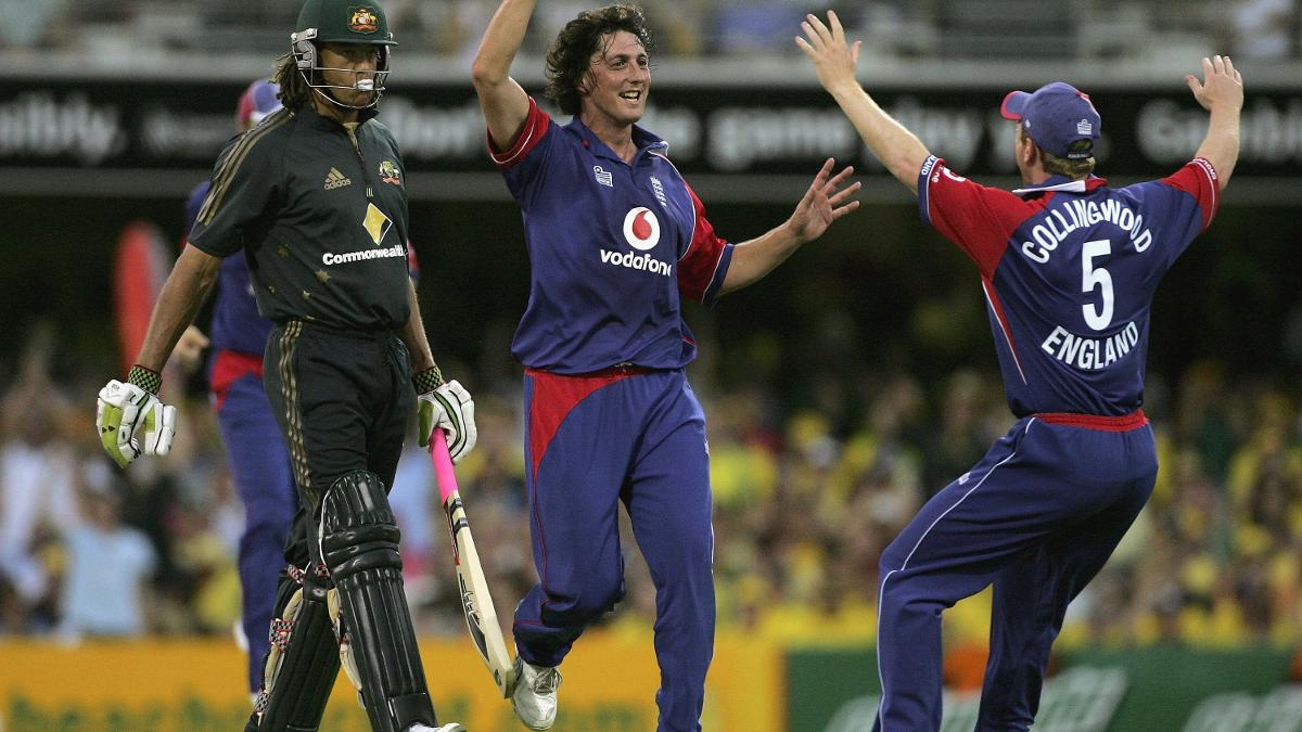 Jon Lewis of England celebrates the wicket of Andrew Symonds
