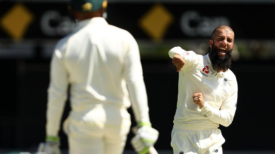 Moeen Ali celebrates the wicket of Usman Khawaja