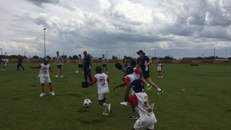 The squad travelled to the outskirts of Potchefstroom, their base for a Tri-Series against South Africa and Namibia, and organised an afternoon of games for local children.