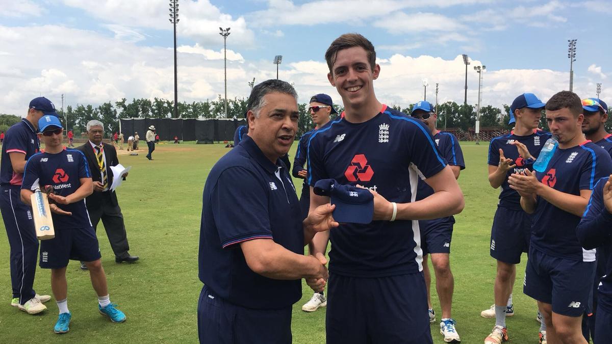 Roman Walker receives his England U19 cap from selector John Abrahams