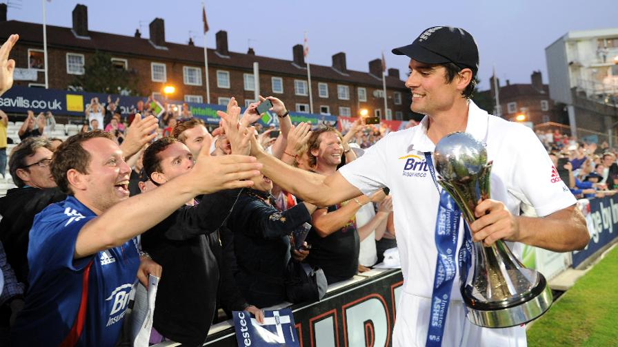 Cook celebrates with fans after England retained the Ashes in 2013