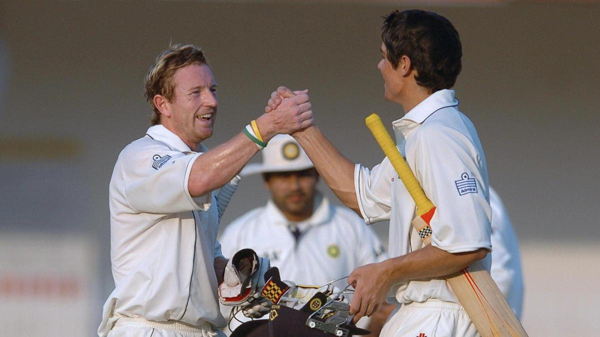 Paul Collingwood congratulates Alastair Cook on his debut hundred in Nagpur
