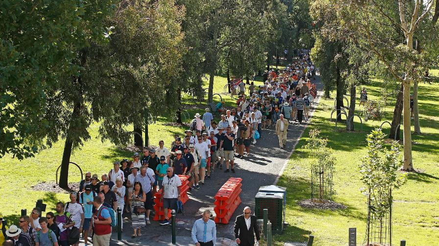 England and Australia fans stream towards the MCG on Boxing Day