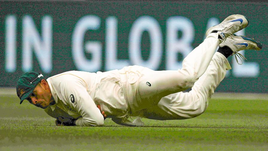 USMAN DOWN - But did he catch it cleanly?