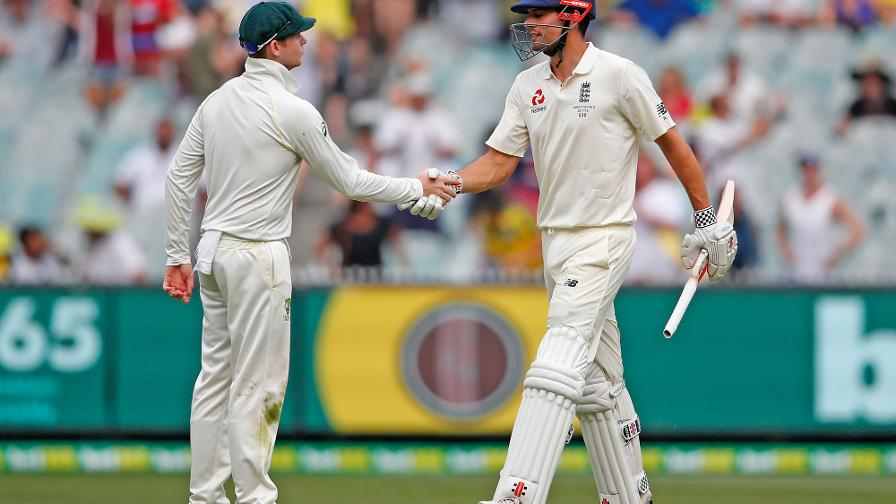A JOB WELL DONE - Steve Smith congratulates Cook