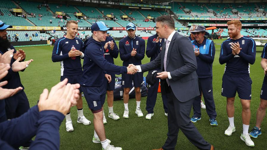 Mason Crane is presented his England Test cap by Graeme Swann