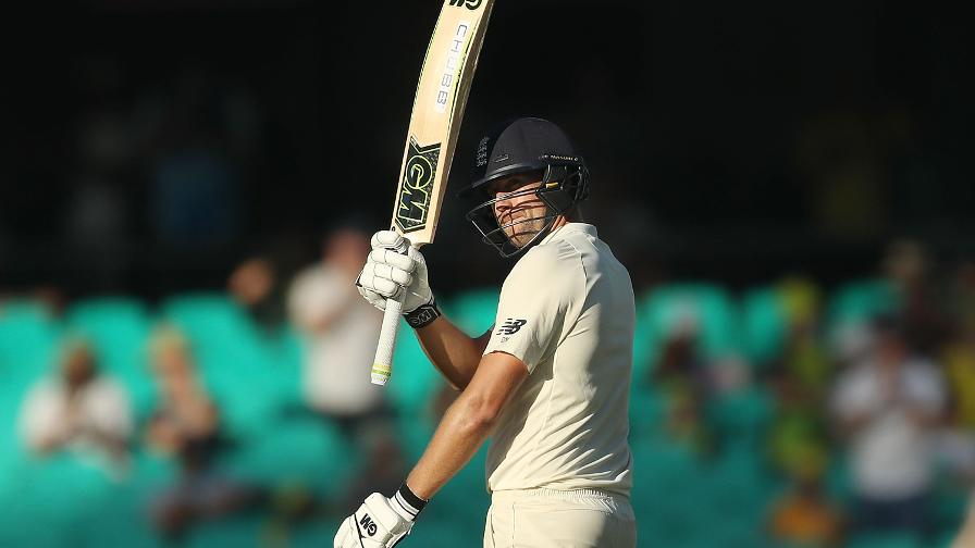 MAIN MALAN - England's no.5 hold his bat aloft after reaching 50
