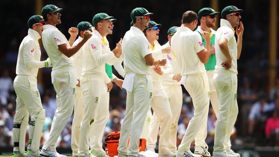 EYES ON THE PRIZE - The Aussies watch as DRS gives Cook out