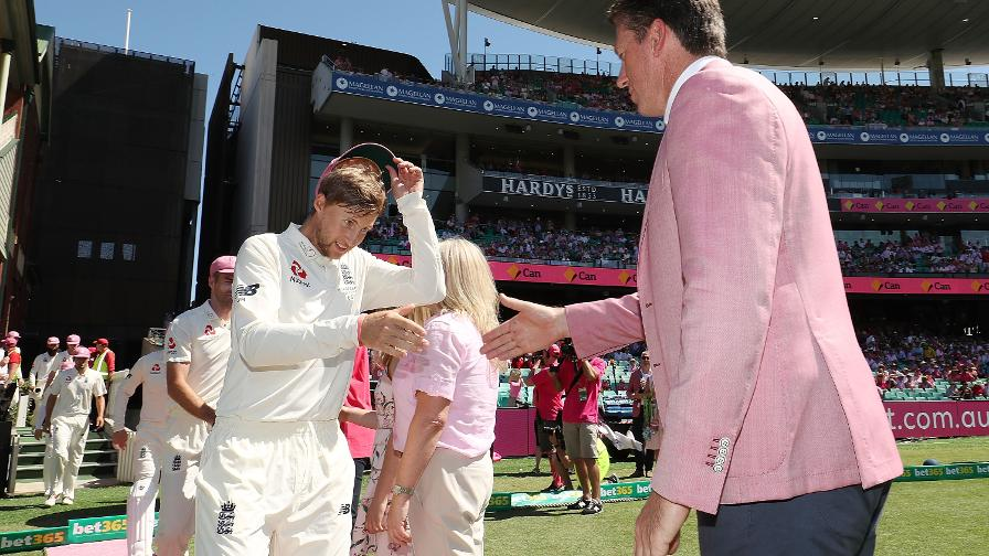 GOOD CAUSE - Joe Root presents his pink Test cap to Glenn McGrath