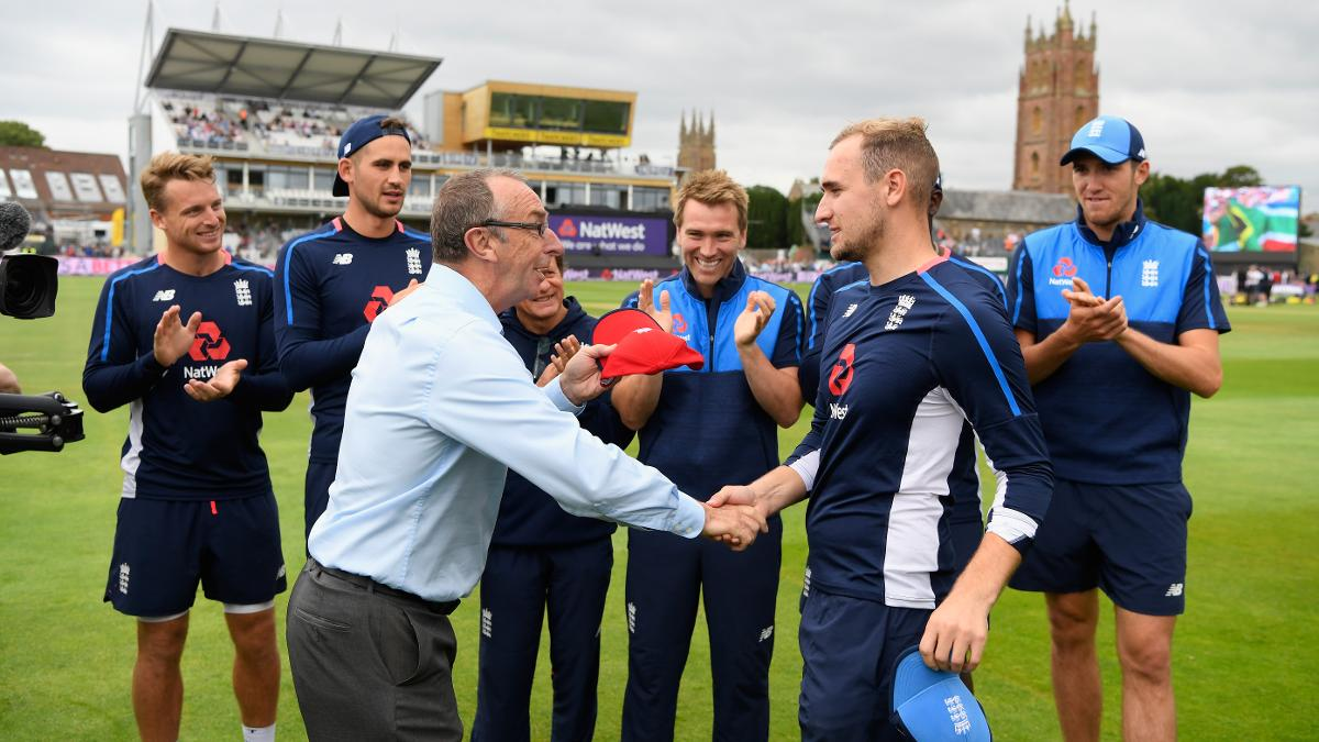 Liam Livingstone receives his England IT20 cap from David Lloyd