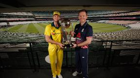 Eoin Morgan and Steve Smith with the World Cup trophy