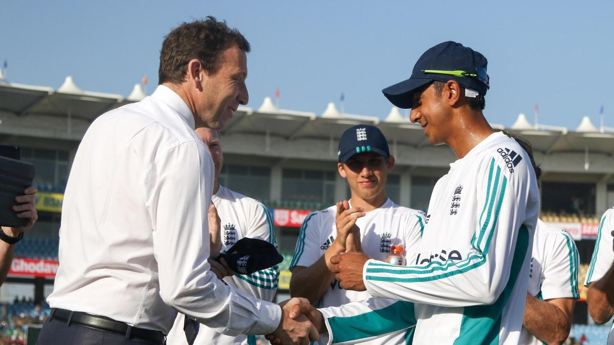 Haseeb Hameed is presented with his Test cap by Michael Atherton