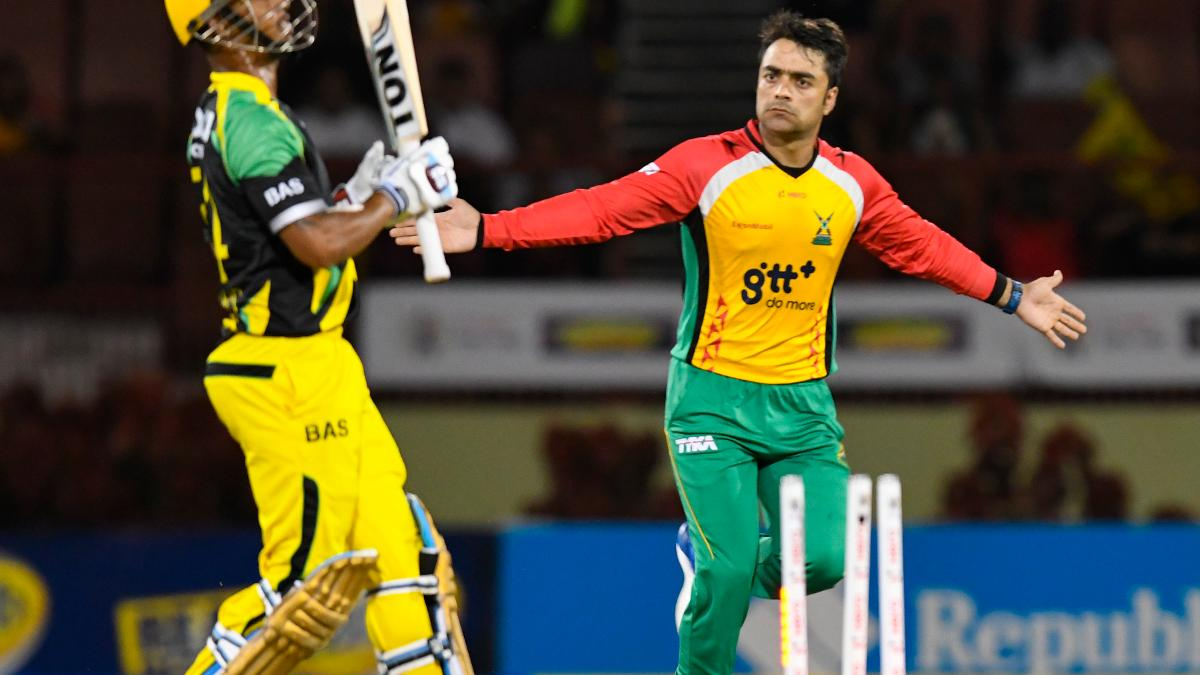 Rashid Khan in action for Guyana Amazon Warriors celebrates the dismissal of Lendl Simmons