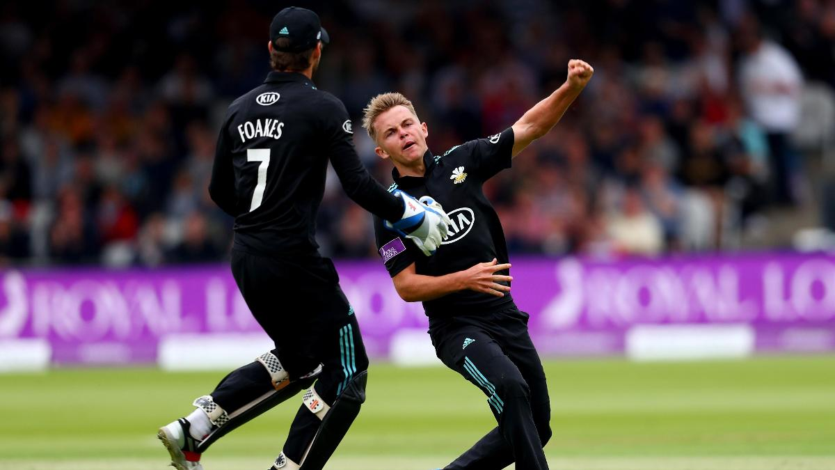 Sam Curran celebrates with Ben Foakes during Surrey's defeat in last year's final