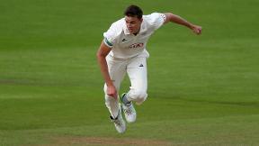 Surrey complete emphatic triumph