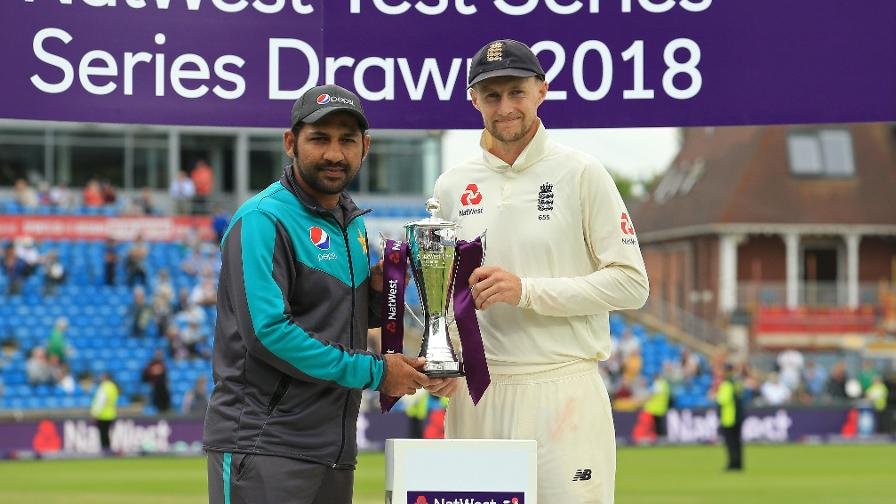 Captains Joe Root and Sarfraz Ahmed share the trophy after drawing the NatWest Test Series #NoBoundaries