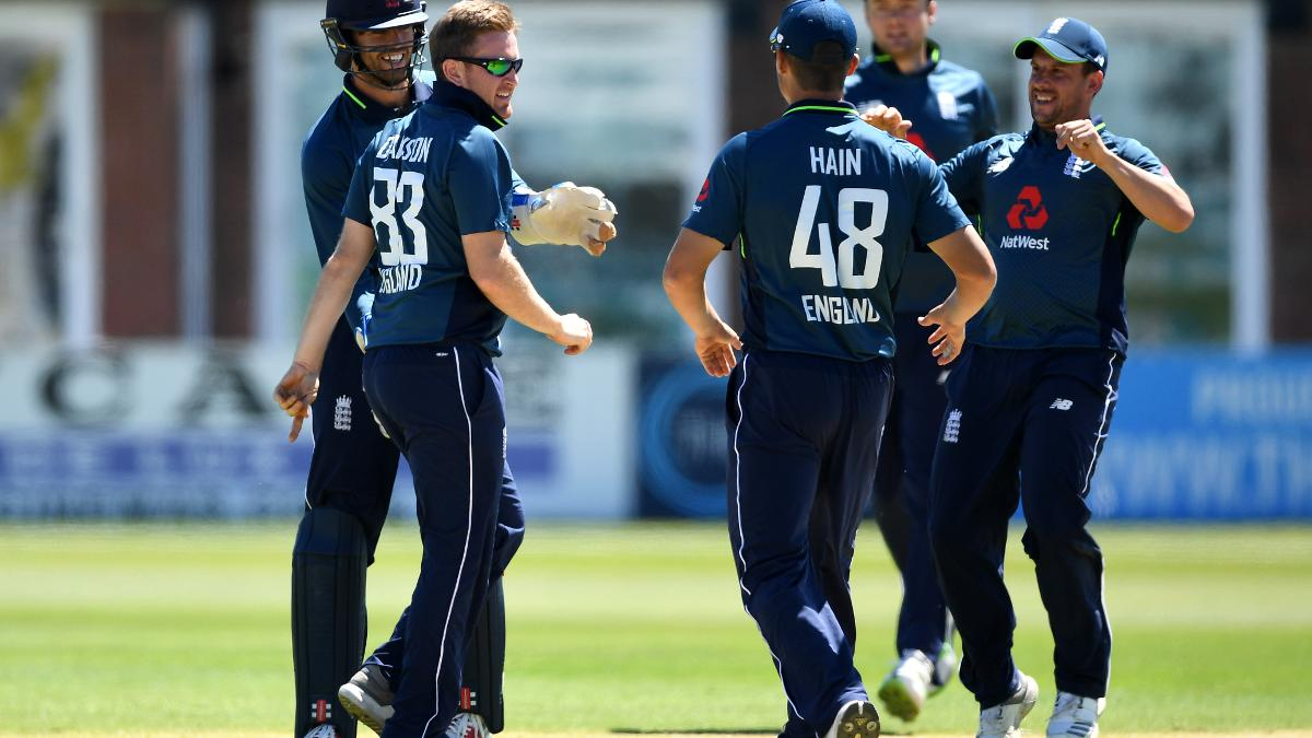 Liam Dawson is congratulated by his England Lions team-mates