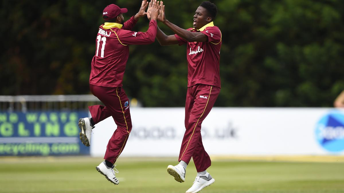 Chemar K Holder celebrates with Chandrapaul Hemraj after he claims the wicket of Nick Gubbins