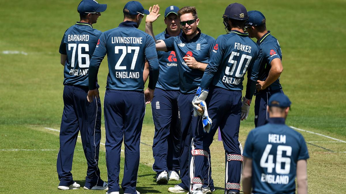 Liam Dawson surrounded by his team-mates - the 28-year-old had Windies A in a spin
