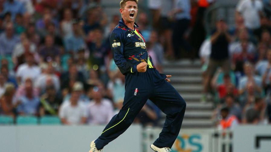 Joe Denly celebrates taking a hat-trick having already hit a hundred