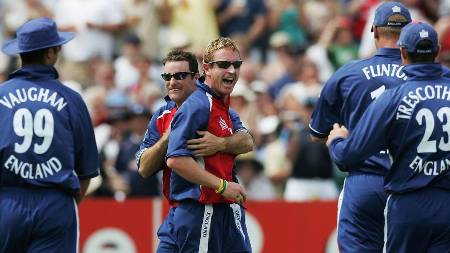 England team-mates mob Collingwood after taking a stunning catch to dismiss Matthew Hayden in 2005